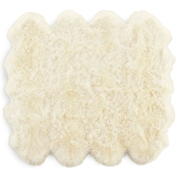 Neutral Living with Sheepskin Rug by Two Thirty Five Designs
