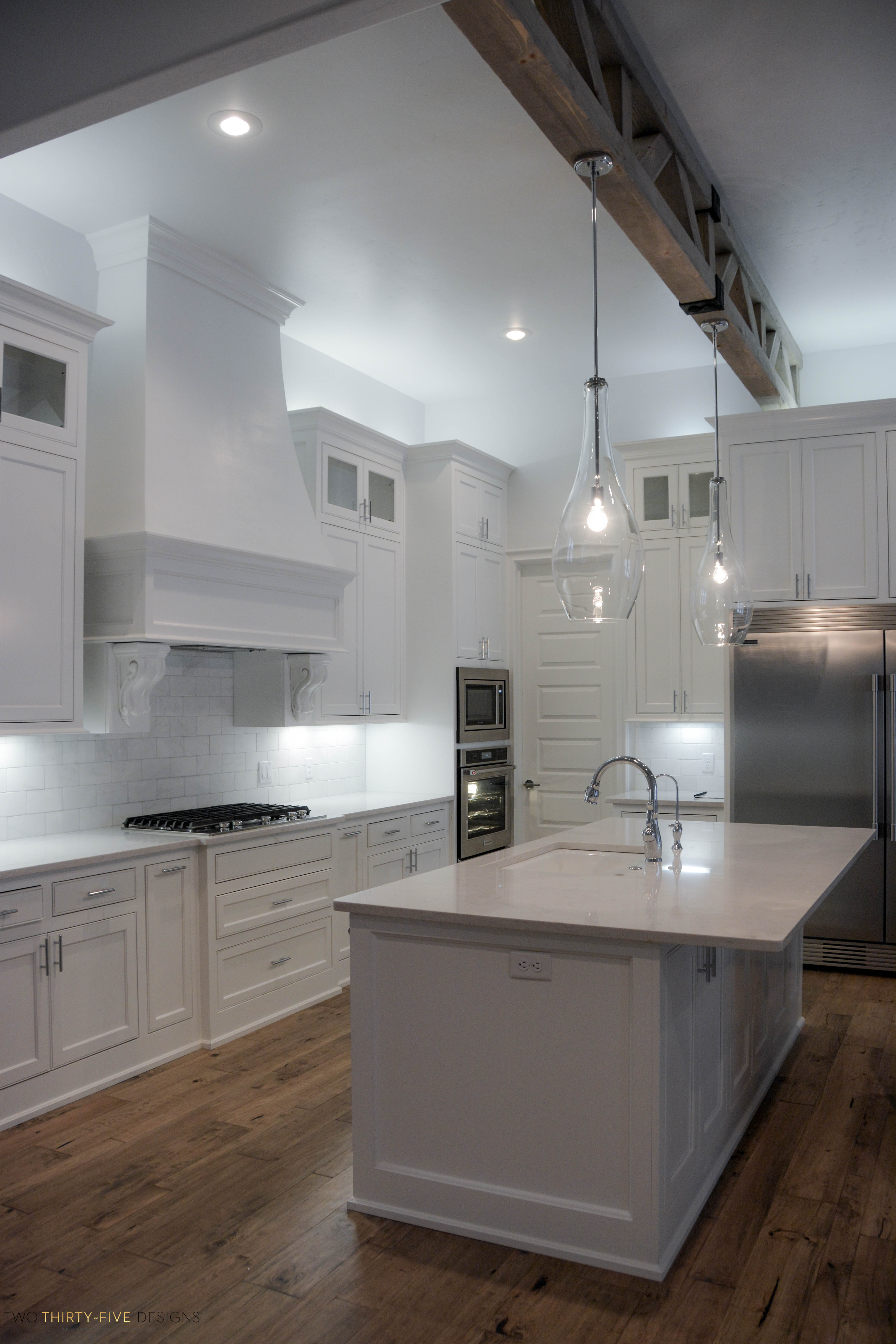 Simple-White-Kitchen-5-of-10 Simple Home Floor Designs on simple home kitchen designs, simple home building designs, simple home architecture, simple home furniture, simple home exterior designs, simple home lighting, simple home bathroom designs, simple business card designs, simple home bar designs, simple home swimming pools,