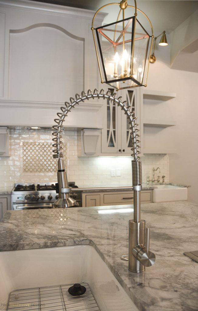 Rustic French Kitchen with Industrial Faucet by Two Thirty Five Designs